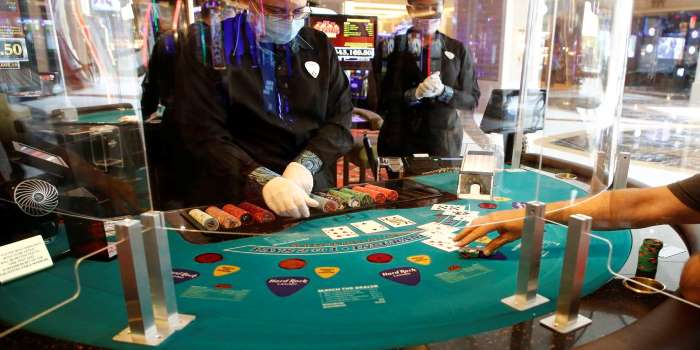 a blackjack table with plexiglass separators