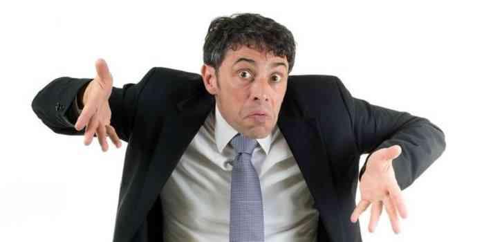 man in suit shrugging