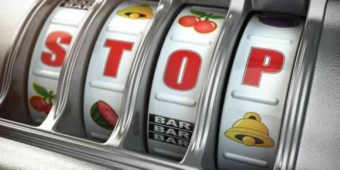 slot machine saying stop for gambling addiction